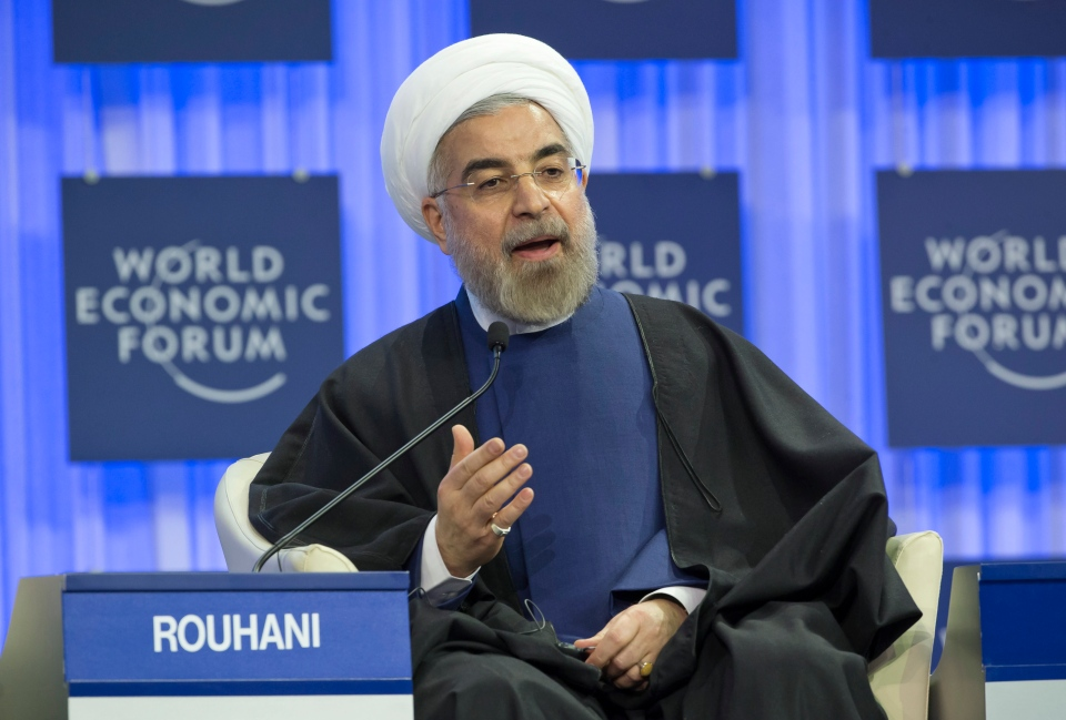Iranian President Hassan Rouhani, gestures as speaks during a session of the World Economic Forum in Davos, Switzerland, Thursday, Jan. 23, 2014.  (AP / Michel Euler)