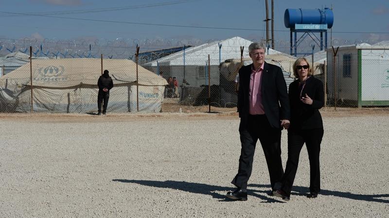 Prime Minister Stephen Harper and wife Laureen Harper visit Za'atari Refugee Camp in Jordan on Friday, January 24, 2014. (Sean Kilpatrick / THE CANADIAN PRESS))