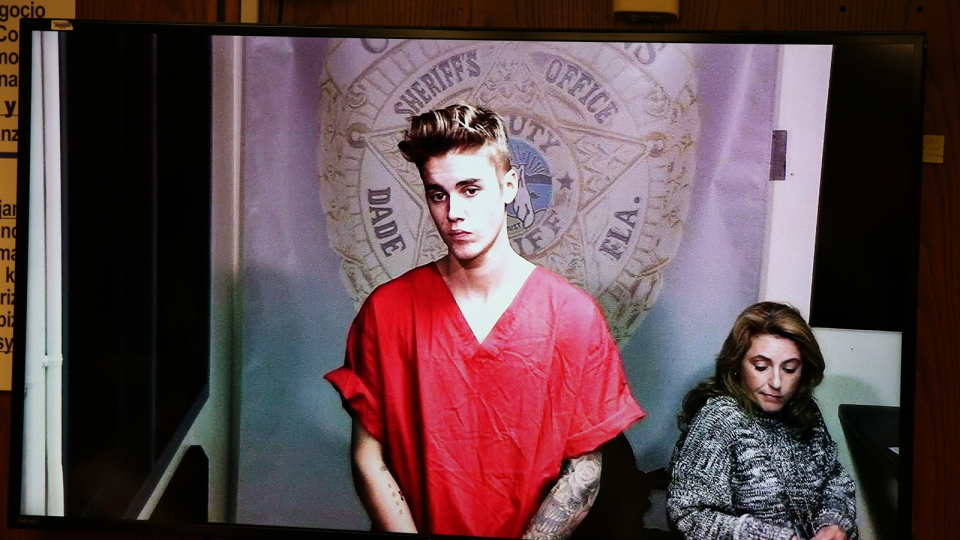 Justin Bieber appears in court via video feed, Thursday, Jan. 23, 2014 in Miami. (The Miami Herald / Walter Michot)