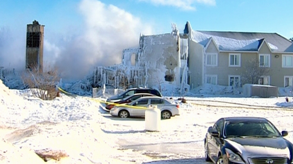 The frozen rubble of the seniors residence destroyed in a fatal fire sits frozen in L'Isle-Verte, Que., Friday, Jan. 24, 2014.