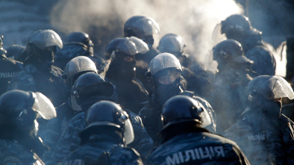 Standing in frozen air riot police guard a government district in central Kyiv, Ukraine, Friday, Jan. 24, 2014. (AP / Sergei Grits)