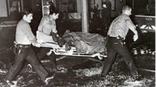 "A photo from the horrific night shows emergency staff removing a victim on a stretcher. (Photo credit: ""Le Memorial de Qu�bec Edition 1966-76"" published in 1979 by the National Library of Quebec)"