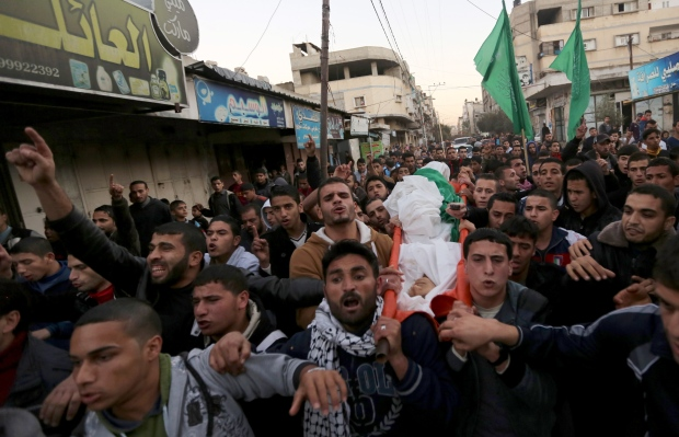 Mourners carry the body of Awidia on Gaza Strip