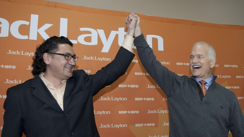 NDP Leader Jack Layton, right, raises the hand of candidate Romeo Saganash at a rally Monday, April 18, 2011 in Val d'Or, Que. THE CANADIAN PRESS/Jacques Boissinot