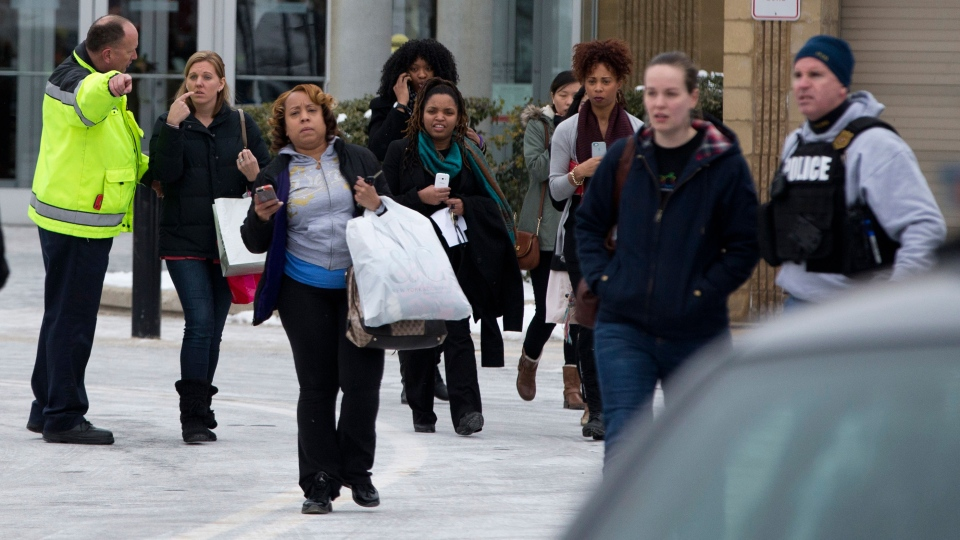Shoppers are evacuated by police after a shooting at The Mall in Columbia in Columbia, Md. on Saturday, Jan. 25, 2014. (AP / Evan Vucci)