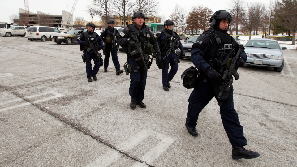 Police move in from a parking lot to the Mall in Columbia after reports of a multiple shooting in Howard County, Md., Saturday Jan. 25, 2014. (AP / Jose Luis Magana)