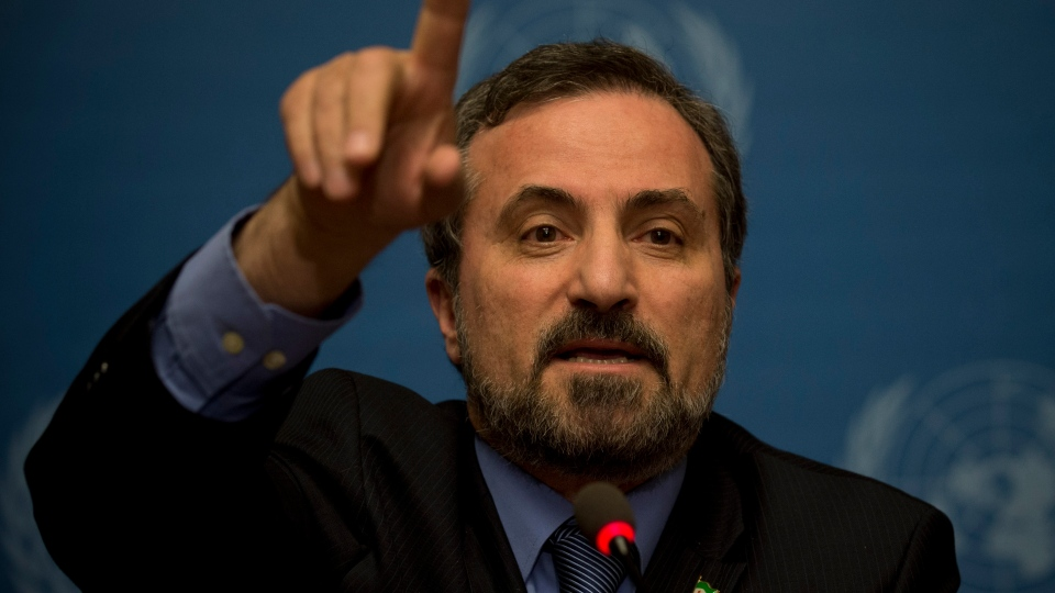 Louay Safi, spokesperson for the Syrian National Coalition, Syria's main political opposition group, gestures as he speaks to journalists at the United Nations headquarters in Geneva, Switzerland, Switzerland, Saturday, Jan. 25, 2014. (AP / Anja Niedringhaus)