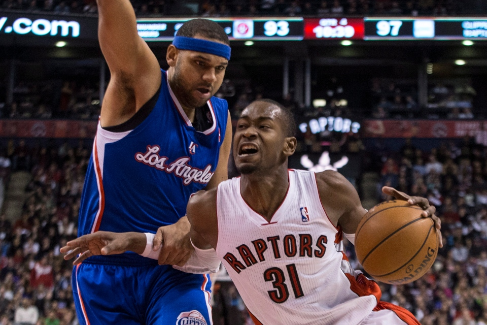 Toronto Raptors' Terrence Ross (right) drives past Los Angeles Clippers' Jared Dudley during second half NBA basketball action in Toronto on Saturday January 25 , 2014. (Chris Young / THE CANADIAN PRESS)