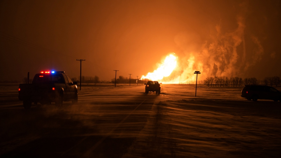 Fire fills the sky after a pipeline explosion in Otterburne, Man. on Saturday, Jan. 25, 2014. (MyNews / Jordan McRae)