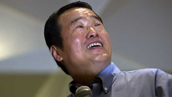 Huang Nubo, chairman of Zhong Kun Group, reacts as he introduces his land-purchasing plan in Iceland to the press at a meeting room of his company's headquarters building in Beijing, China, Friday, Sept. 2, 2011.