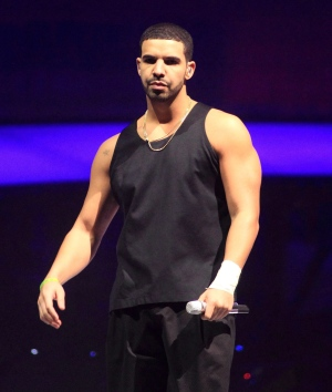 Rapper Drake performs in concert on the last date of his 'Would You Like A Tour? 2013' at the Wells Fargo Center  in Philadelphia on Wednesday, Dec. 18, 2013.  (Owen Sweeney/Invision)
