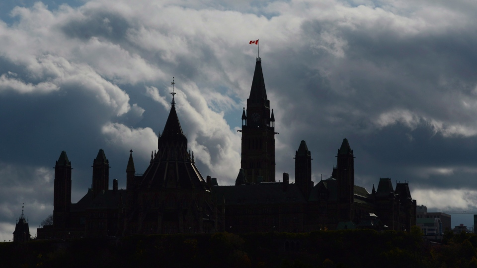 Clouds form a backdrop for the buildings on Parliament Hill in Ottawa on Tuesday, Oct. 22, 2013. (Sean Kilpatrick / THE CANADIAN PRESS)