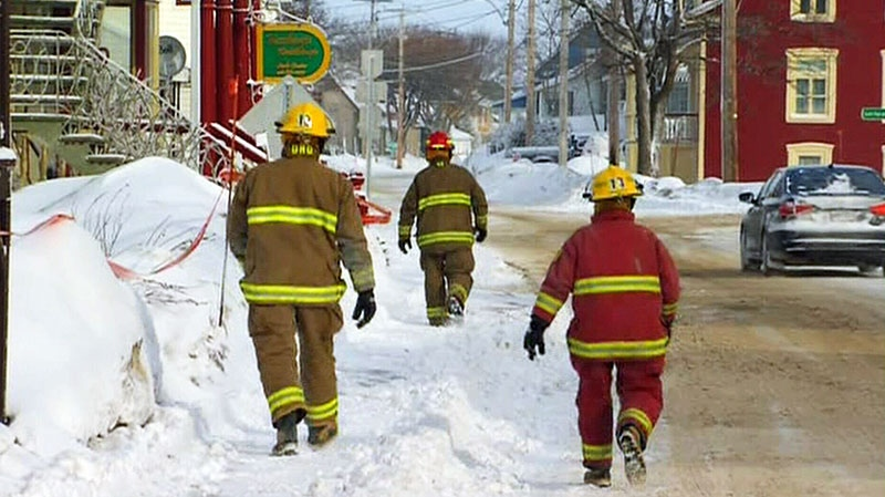 Firefighters are on the scene after a deadly fire on Thursday, Jan. 22 in L'Isle-Verte, Quebec on Sunday, Jan. 26, 2014.