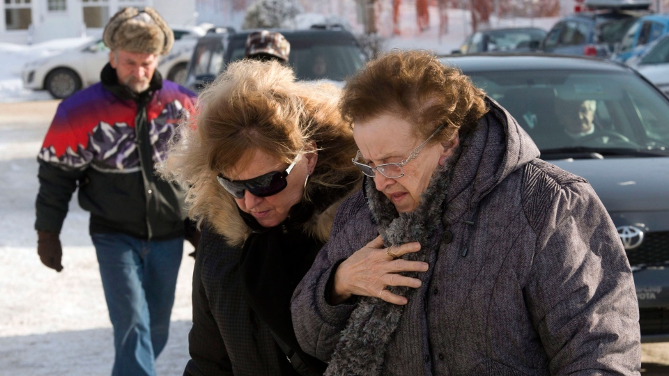 People arrive for a commemorative service for victims of last week's fatal fire at a seniors residence in L'Isle-Verte, Que. on Sunday, January 26, 2014. (Ryan Remiorz / THE CANADIAN PRESS)