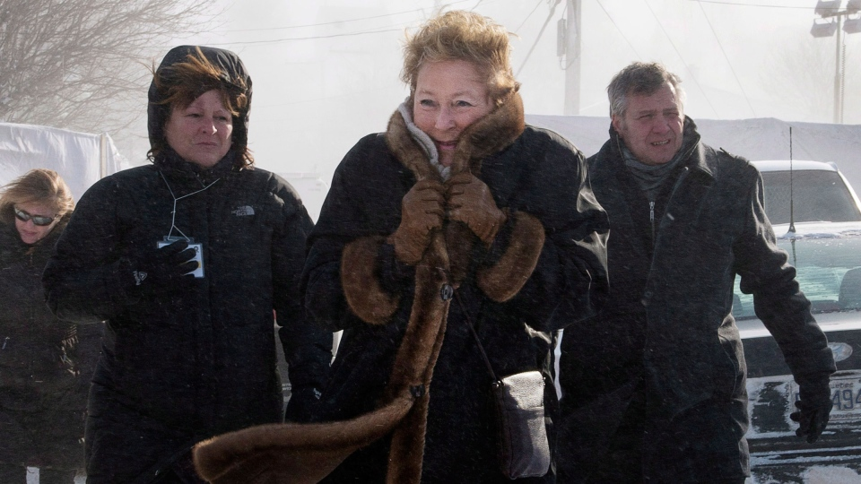 Quebec Premier Pauline Marois visits the site of the fatal fire at a seniors residence in L'Isle-Verte, Que. on Sunday, January 26, 2014. (Ryan Remiorz / THE CANADIAN PRESS)
