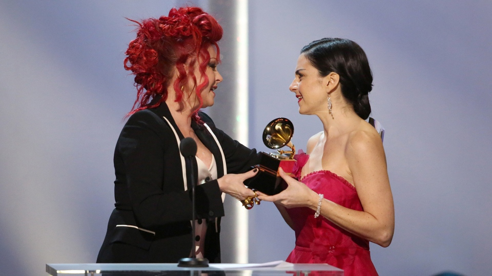 Cyndi Lauper, left, presents the best children's album award to Jennifer Gasoi for 'Throw A Penny In The Wishing Well' at the pre-telecast of the 56th annual GRAMMY Awards on Sunday, Jan. 26, 2014, in Los Angeles. (Matt Sayles / Invision)