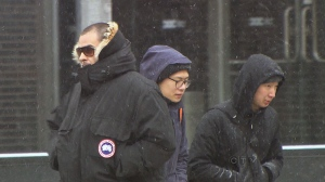 Torontonians bundle up in cold weather conditions on Sunday, Jan. 26, 2014.