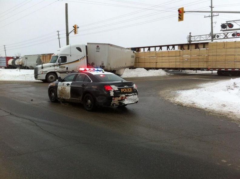 freight train hits tractor trailer