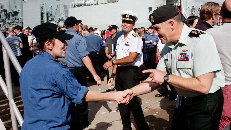 Chief of the Defence Staff, Gen. Walter Natynczyk, right, greets sailors as HMCS Charlottetown returned home to Halifax following a five-month deployment with NATO forces off Libya on Friday, Sept. 2, 2011. (Andrew Vaughan / THE CANADIAN PRESS)