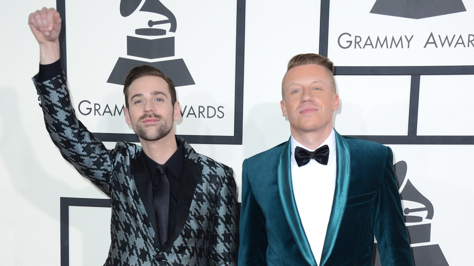Ryan Lewis, left, and Macklemore arrive at the 56th annual Grammy Awards at Staples Center on Sunday, Jan. 26, 2014, in Los Angeles. (Jordan Strauss / Invision)