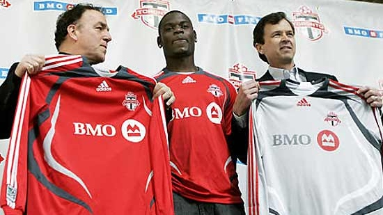 In this undated file photo, members of Toronto FC hold up their team jerseys.