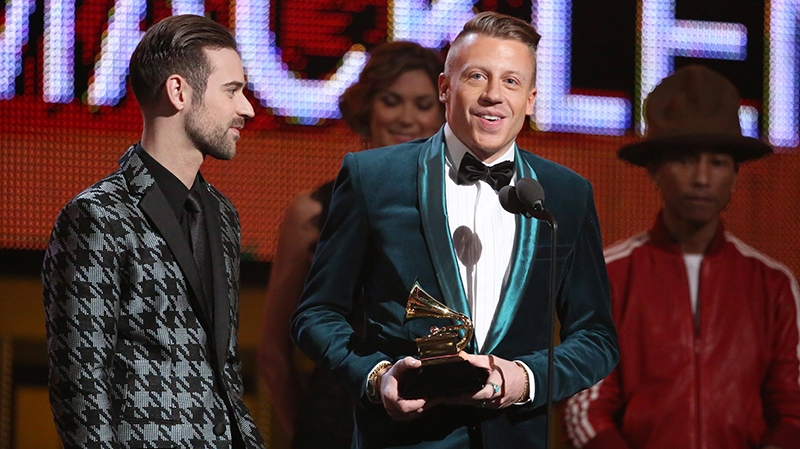 Ryan Lewis, left, and Macklemore accept the award for best new artist at the 56th annual Grammy Awards at Staples Center on Sunday, Jan. 26, 2014, in Los Angeles. (Matt Sayles / Invision)