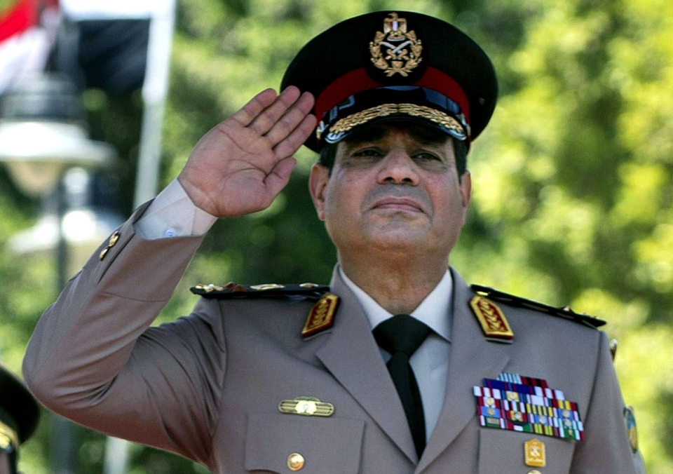 In this Wednesday, April 24, 2013 file photo, Egyptian Defense Minister Gen. Abdel-Fattah el-Sissi salutes during an arrival ceremony for U.S. Secretary of Defense Chuck Hagel at the Ministry of Defense in Cairo. (AP / Jim Watson)