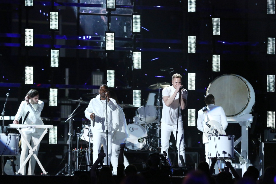 Kendrick Lamar, centre left, and Dan Reynolds, center right, perform at the 56th annual Grammy Awards at Staples Center on Sunday, Jan. 26, 2014, in Los Angeles. (Matt Sayles / Invision)
