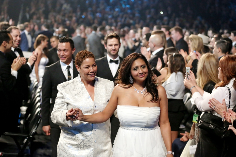 "Audience members participate in a same sex wedding during a performance of ""Same Love"" by Macklemore and Ryan Lewis at the 56th annual Grammy Awards at Staples Center on Sunday, Jan. 26, 2014, in Los Angeles. (AP / Matt Sayles)"