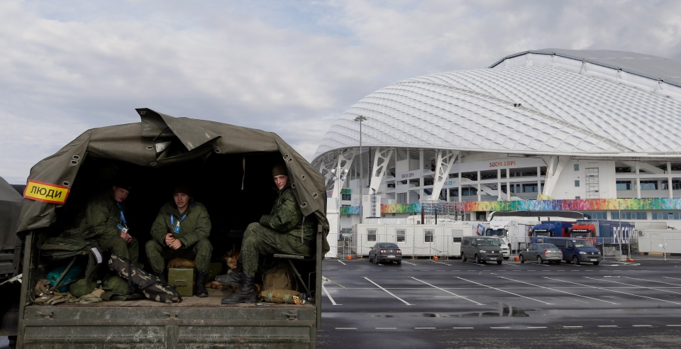 Security personnel sit in the back of a truck outside the Fisht Olympic Stadium at the 2014 Winter Olympics Monday, Jan. 27, 2014, in Sochi, Russia. (AP / David J. Phillip)