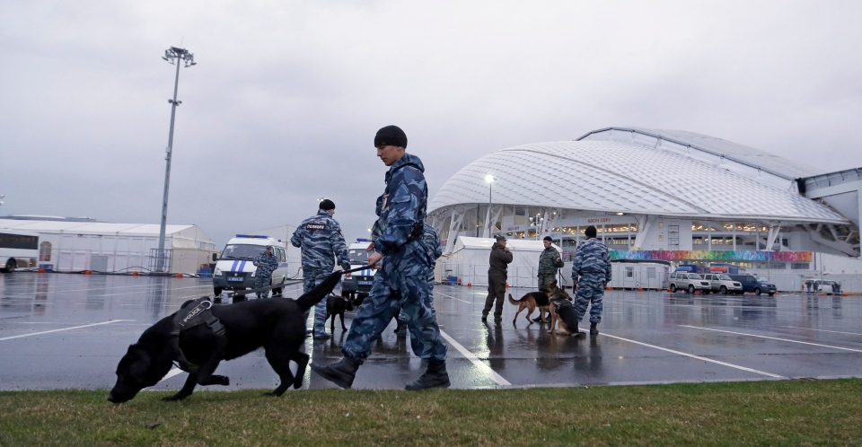 Security personnel walk with their dogs outside Fisht Olympic Stadium in Sochi, Russia Monday, Jan. 27, 2014. (AP / David J. Phillip)