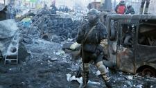 Protester guards barricades in Kyiv, Ukraine