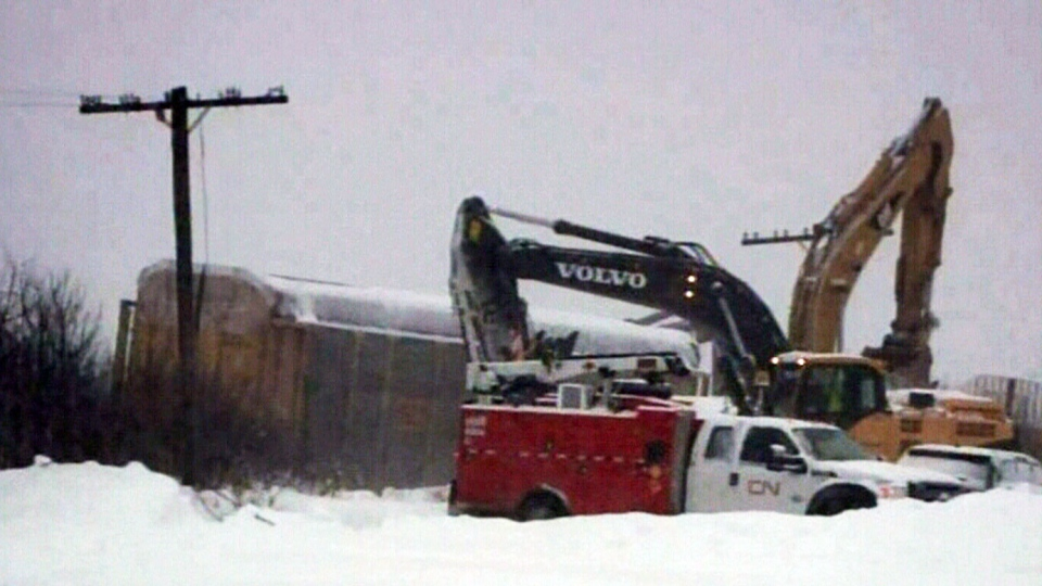 Crews work after a train carrying butane derailed in the northern New Brunswick community of Edmundston, N.B.