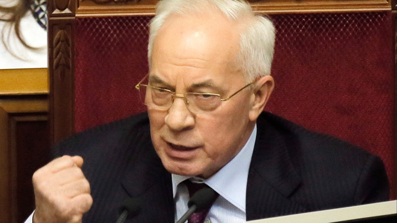 Ukraine's Prime Minister Mykola Azarov speaks to lawmakers during the parliament session in Kyiv, Ukraine, Tuesday, Dec. 3, 2013. (AP / Efrem Lukatsky)