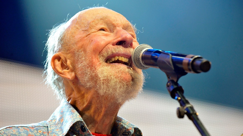 Pete Seeger performs on stage during the Farm Aid 2013 concert at Saratoga Performing Arts Center in Saratoga Springs, N.Y., Sept. 21, 2013. (AP / Hans Pennink)