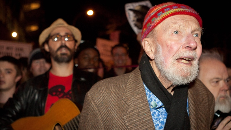 Activist musician Pete Seeger, 92, left, marches with demonstrators sympathetic to the Occupy Wall Street protests in Columbus Circle in New York., Oct. 21, 2011. (AP / John Minchillo)