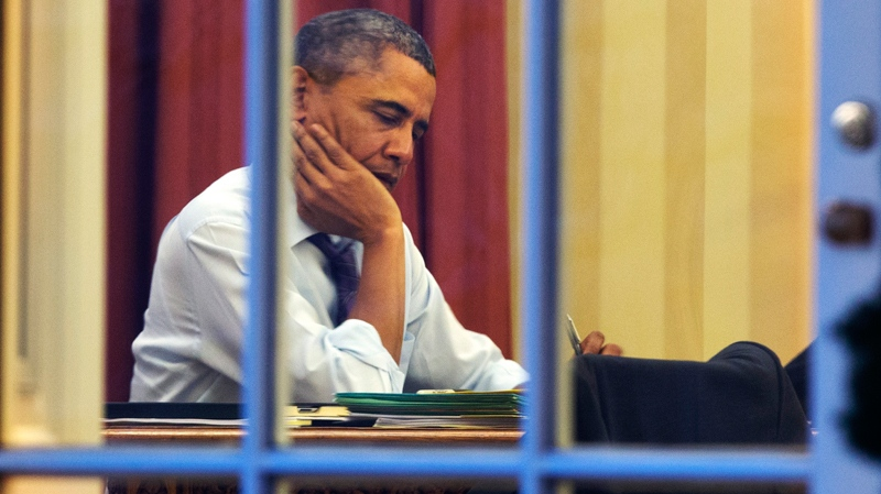 President Barack Obama works at his desk in the Oval Office of the White House in Washington, Monday, Jan. 27, 2014. (AP / Jacquelyn Martin)