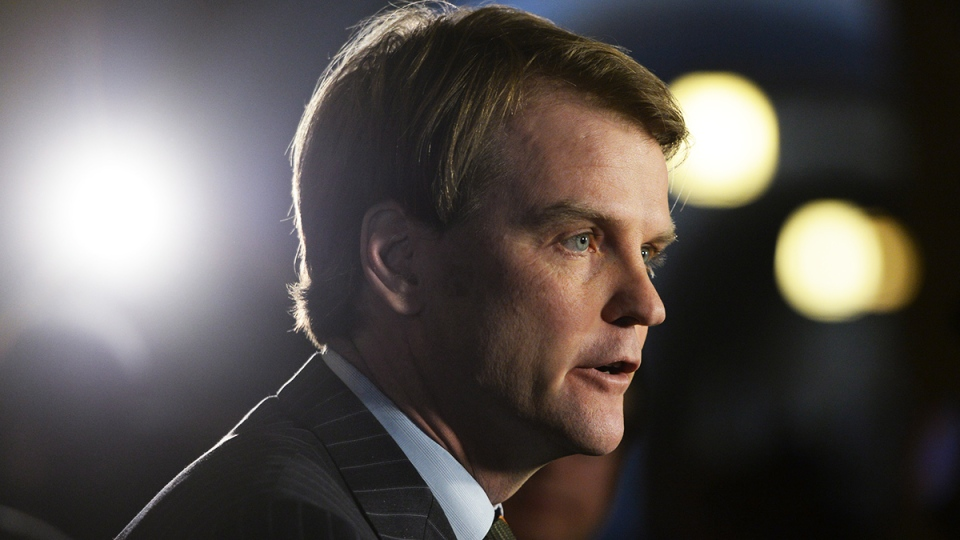 Federal Citizenship and Immigration Minister Chris Alexander talks about the situation in the Ukraine on Parliament Hill in Ottawa, Tuesday, Jan. 28, 2014. (Sean Kilpatrick / THE CANADIAN PRESS)