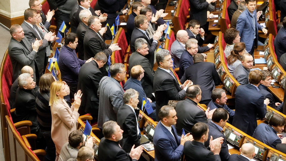 Ukrainian lawmakers applaud after voting during a parliamentary session in Kyiv, Ukraine, Tuesday, Jan. 28, 2014. (AP / Efrem Lukatsky)
