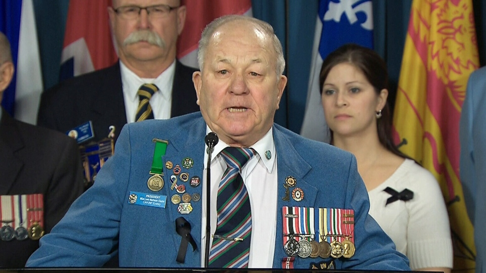 Retired sergeant Ronald Clarke speaks at a news conference in Ottawa on Tuesday, Jan. 28, 2014.