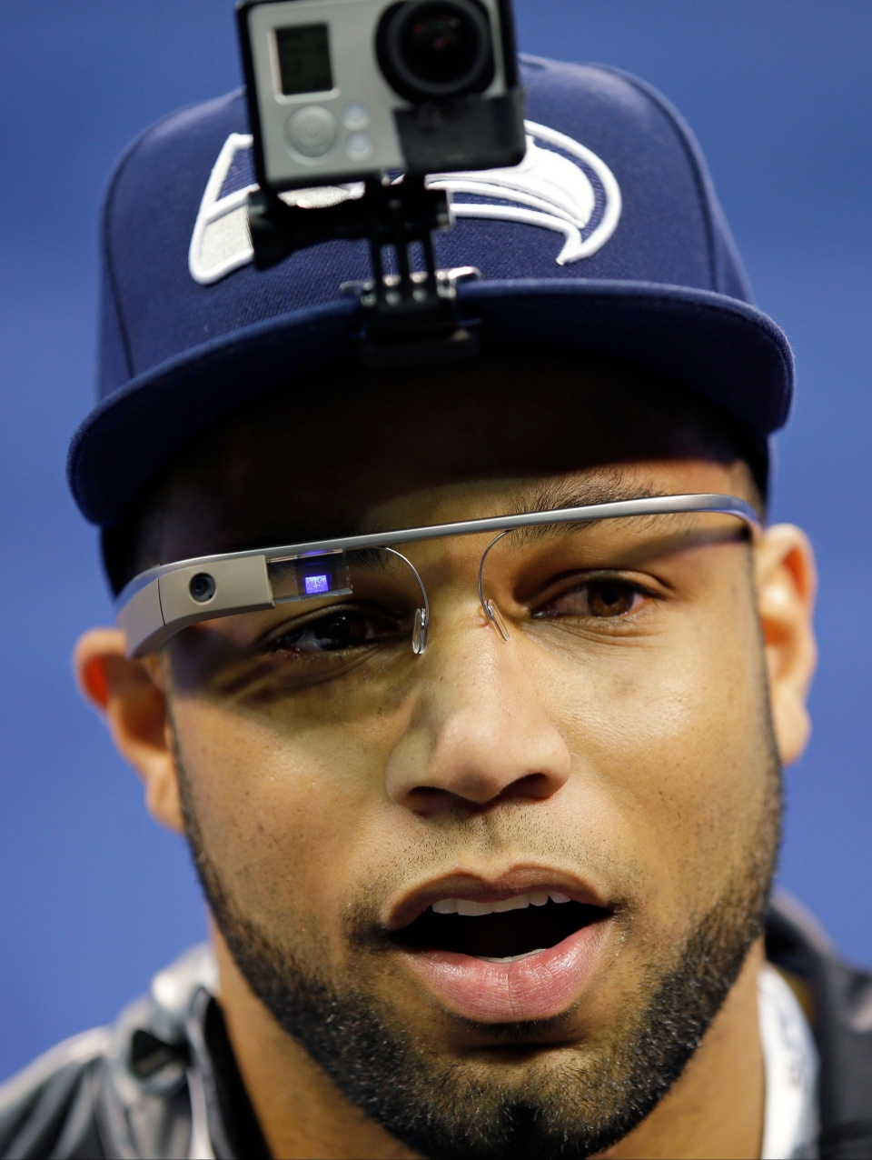 Seattle Seahawks' Golden Tate wears Google glasses during media day for the NFL Super Bowl XLVIII football game Tuesday, Jan. 28, 2014, in Newark, N.J. (AP Photo/Matt Slocum)