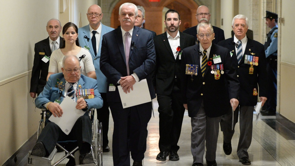Veterans and PSAC members make their way to hold a news conference on Parliament Hill in Ottawa on Tuesday, Jan. 28, 2014. (Sean Kilpatrick / THE CANADIAN PRESS)