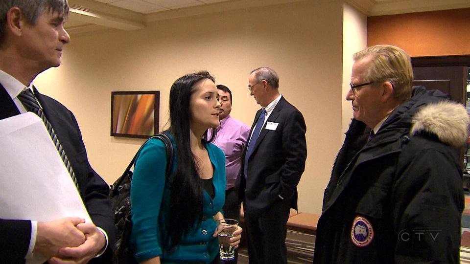 Amanda Gordon, Aglukkaq's assistant, speaks with CTV News reporter Robert Fife in Ottawa, Ont., Tuesday, Jan. 28, 2014.