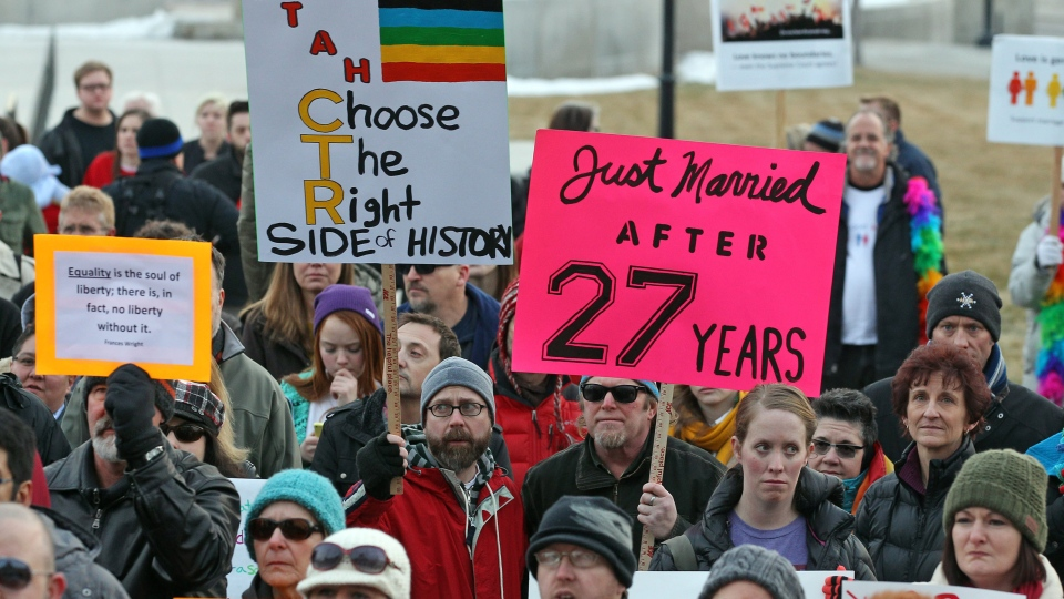 Supporters of gay marriage gather for a rally at the Utah State Capitol, Tuesday, Jan. 28, 2014, in Salt Lake City. Opponents and supporters of gay marriage held twin rallies at the Capitol on Tuesday. (AP / Rick Bowmer)