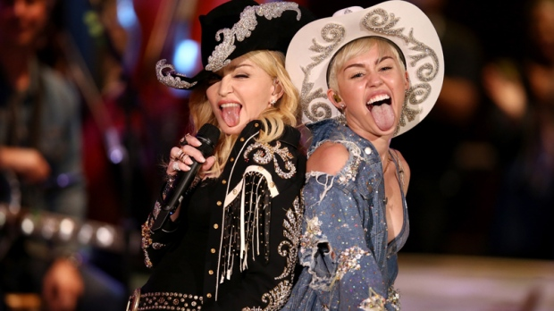 Miley Cyrus performs with Madonna for MTV