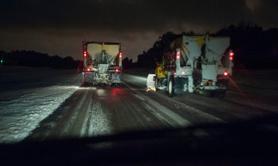 Snow plows making headway along North Carolina 24 East during the early morning hours, Wednesday, Jan. 29, 2014. (The Fayetteville Observer /, Johnny Horne)