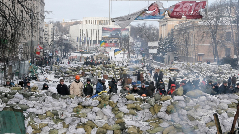 Protesters guard the barricades in front of riot police in Kyiv, Ukraine, Wednesday, Jan. 29, 2014. (AP / Efrem Lukatsky)
