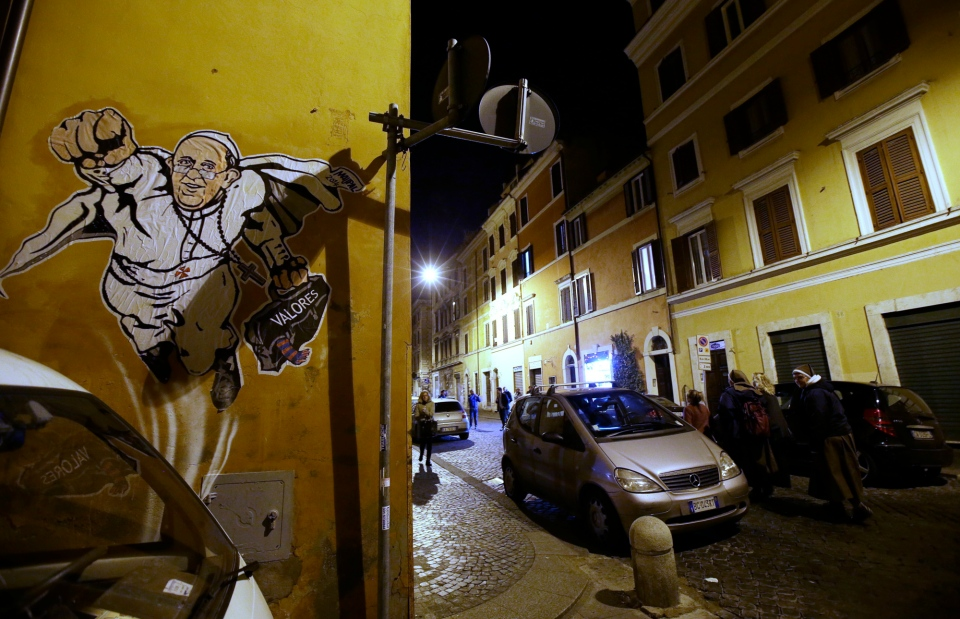 "A graffiti depicting Pope Francis as Superman and holding a bag with a writing which reads: ""Values"" is seen on a wall of the Borgo Pio district near St. Peter's Square in Rome, Tuesday, Jan. 28, 2014. (AP / Gregorio Borgia)"