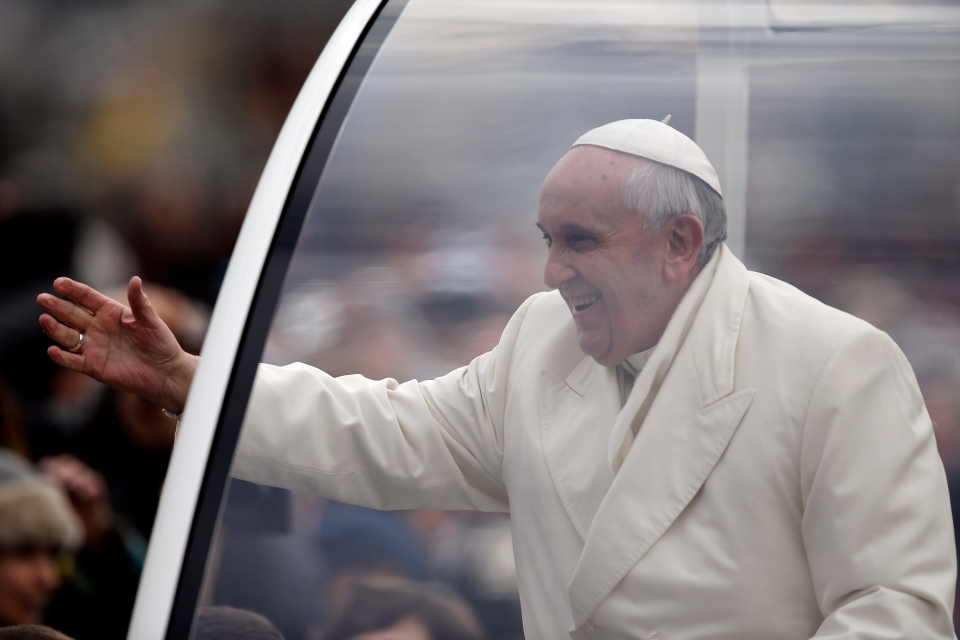 Pope Francis greets faithful as he arrives in his pope-mobile in St. Peter's Square for the weekly general audience at the Vatican, Wednesday, Jan. 29, 2014. (AP / Gregorio Borgia)