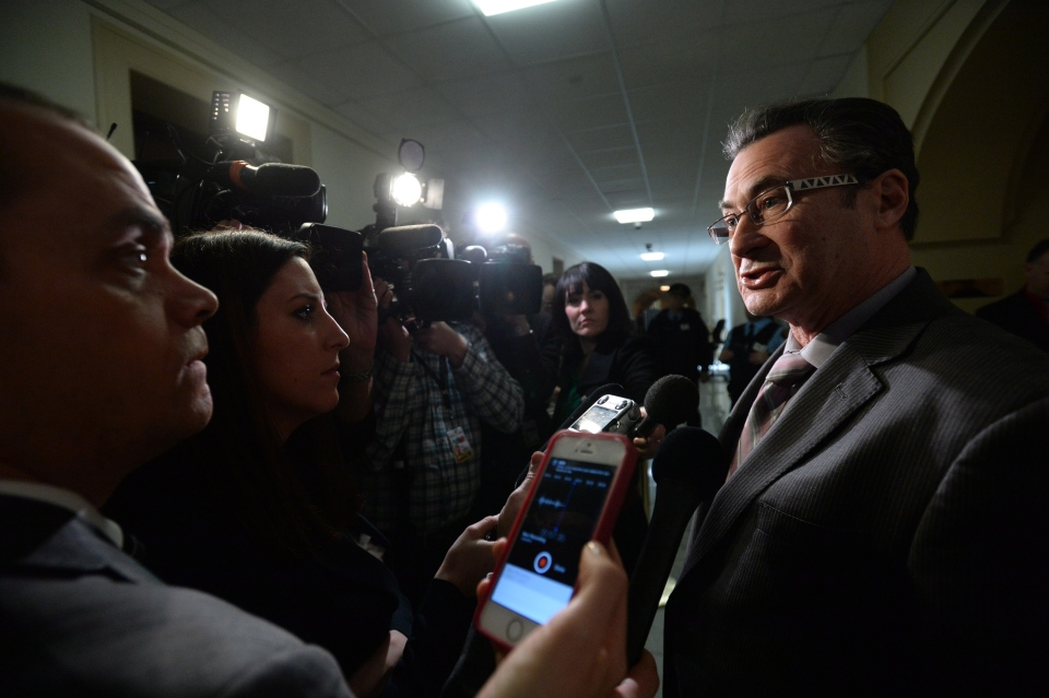 Liberal senator George Baker, reacts to Leberal leader Justin Trudeau's proposal to boot senators from the caucus in Ottawa on Wednesday, Jan. 29, 2014. (Sean Kilpatrick / THE CANADIAN PRESS)